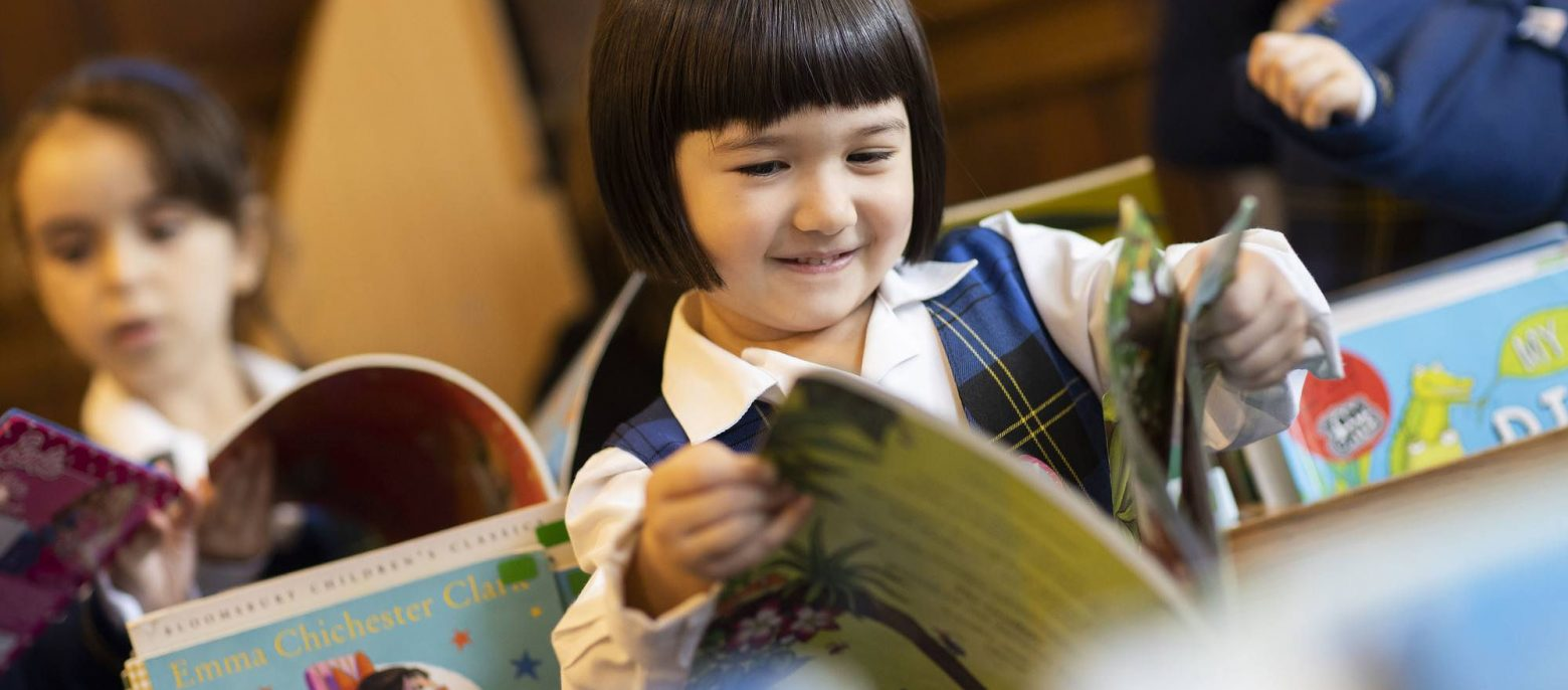 school girls reading in the library