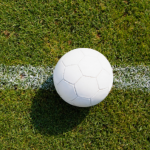 White football on grass pitch